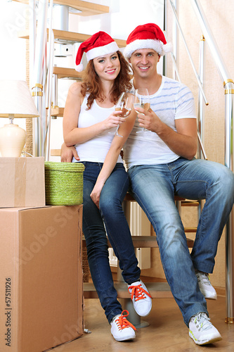 Young couple celebrating New Years in new home