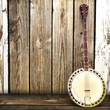 Banjo leaning on a wooden fence. Room for advertisment - 57513782
