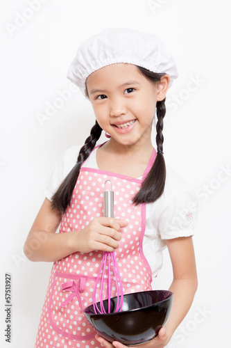 Little Asian cute chef wearing pink apron