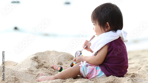Baby play sand on the beach