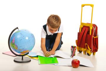 Boy making homework