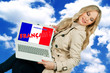 woman holding laptop with french language sign