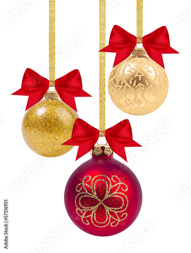 Red and yellow Christmas balls with ribbon and bow on white