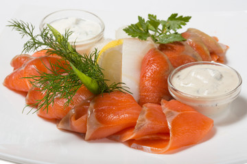 Cold appetizer of smoked halibut, salted trout, sockeye salmon s