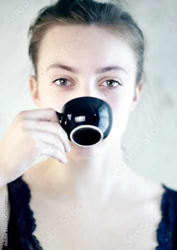 young Woman is drinking Espresso