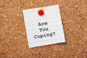 Are You Coping? message on a cork notice board