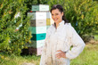 Portrait Of Confident Female Beekeeper At Apiary