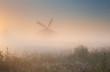 windmill silhouette in sunrise fog