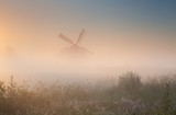 windmill silhouette in sunrise fog