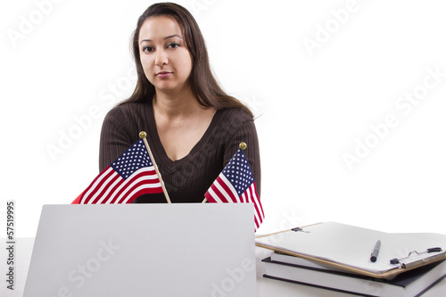 State or Federal female worker with a blank sign on her desk