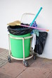 trash can with broom and garbage