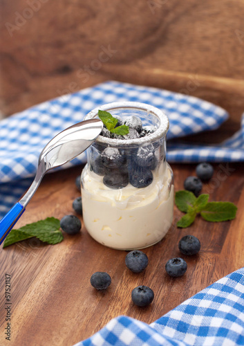 Fresh yogurt with blueberry and mint in a glass jar