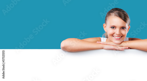 Smiling blonde woman lying on copyspace