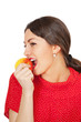 Pretty young woman eating apple