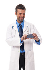 Handsome doctor text messaging