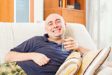 Relaxed man with glass