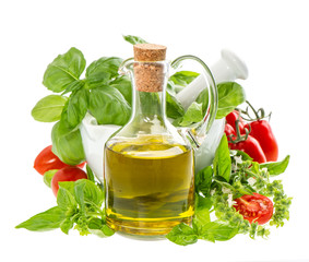 bottle of olive oil with fresh mediterranean herbs