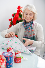 Woman Wrapping Christmas Present