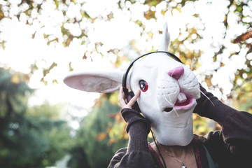 rabbit mask woman listening to music