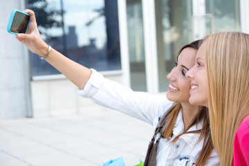 Two friends taking photos with a smartphone