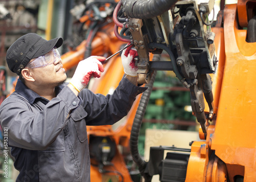 Repairman in factory