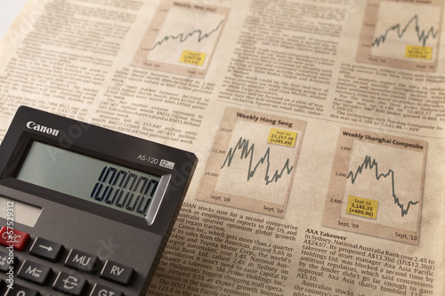 Newspaper stock market with calculator
