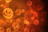 Halloween background with laughing pumpkins bokeh lights