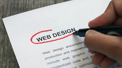 Circling Web Design with a red marker