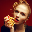 Unhealthy eating. Junk food concept. Girl eating fried potato
