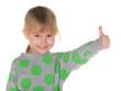 Smiling little girl holds thumb up