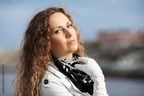 Beautiful woman with curly hairs