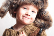 funny smiling child in fur hat.fashion.winter style.children