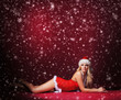 Young sexy Santa in lingerie over red background