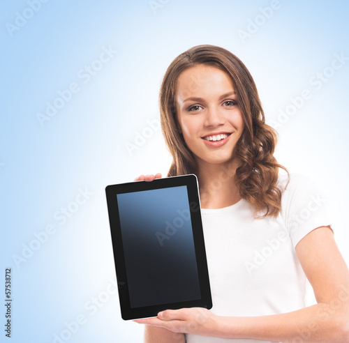 A girl holding a tablet computer over blue background