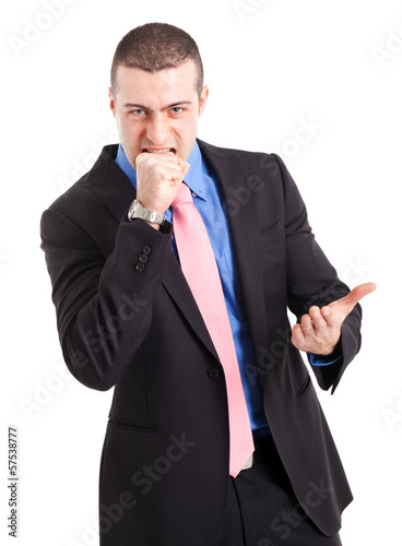 Portrait of an angry businessman. Isolated on white