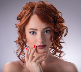 Portrait of young red-haired girl
