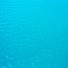 Bright cyan blue  sea water may use as background or texture.