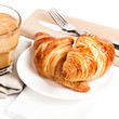 Breakfast with Coffee cup and  Croissants on a plate and linen n