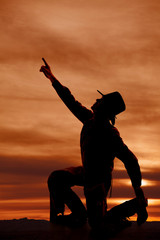 cowboy kneel silhouette point up