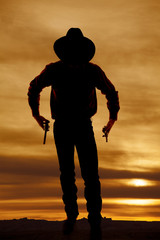 cowboy silhouette two guns