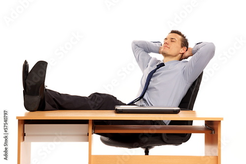 Young businessman at shirt and tie relaxing in work