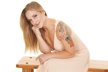 woman stripe dress tattoo sit smile lean