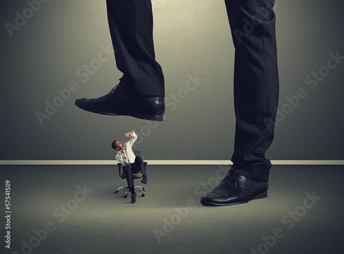 small man under big leg