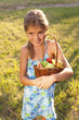little girl with  basket of fresh fruit