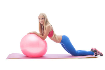 Lovely young blonde doing fitness in studio