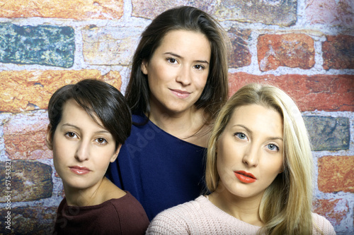 Three young beautiful girls portrait color image