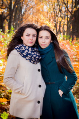 Young girls in the autumn park