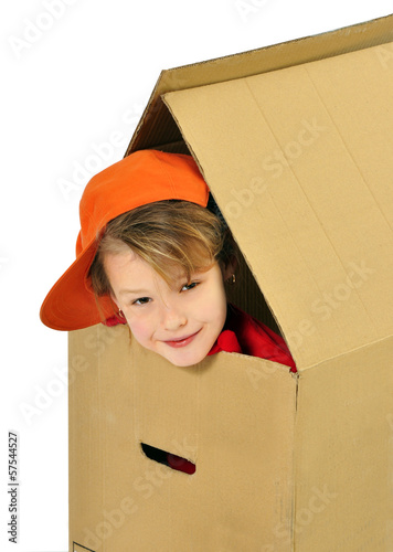 Girl playing a toy house