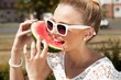 Woman takes watermelon. Concept of healthy and dieting food