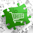 Shopping Cart Icon on Green Puzzle.
